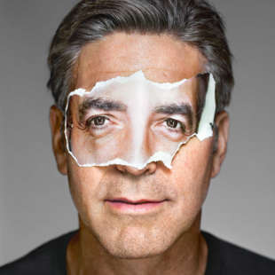 Portrait of George Clooney's head in frontal view with paper mask in front of his eyes showing his own eyes in front of a white background
