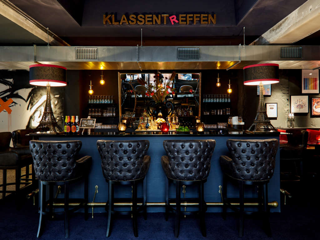 Hotel bar with black and blue interior and dimmed lights